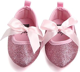 Beautiful pink glittered baby girl shoes