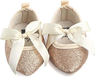 Beautiful golden glittered baby girl shoes
