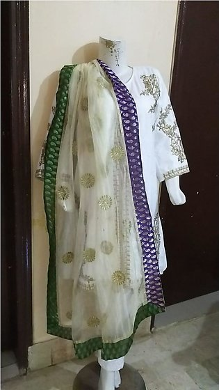 White color embroidered & stitched three piece suit for females stuff cotton by…