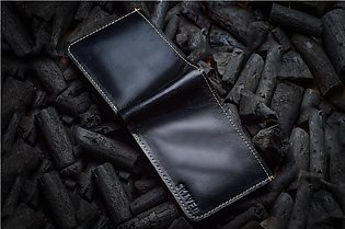 Bi-fold leather wallet by Skived