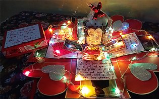 Explosionn Box having teddy bear,chocolates,notes,pictures and a ring box enclo…